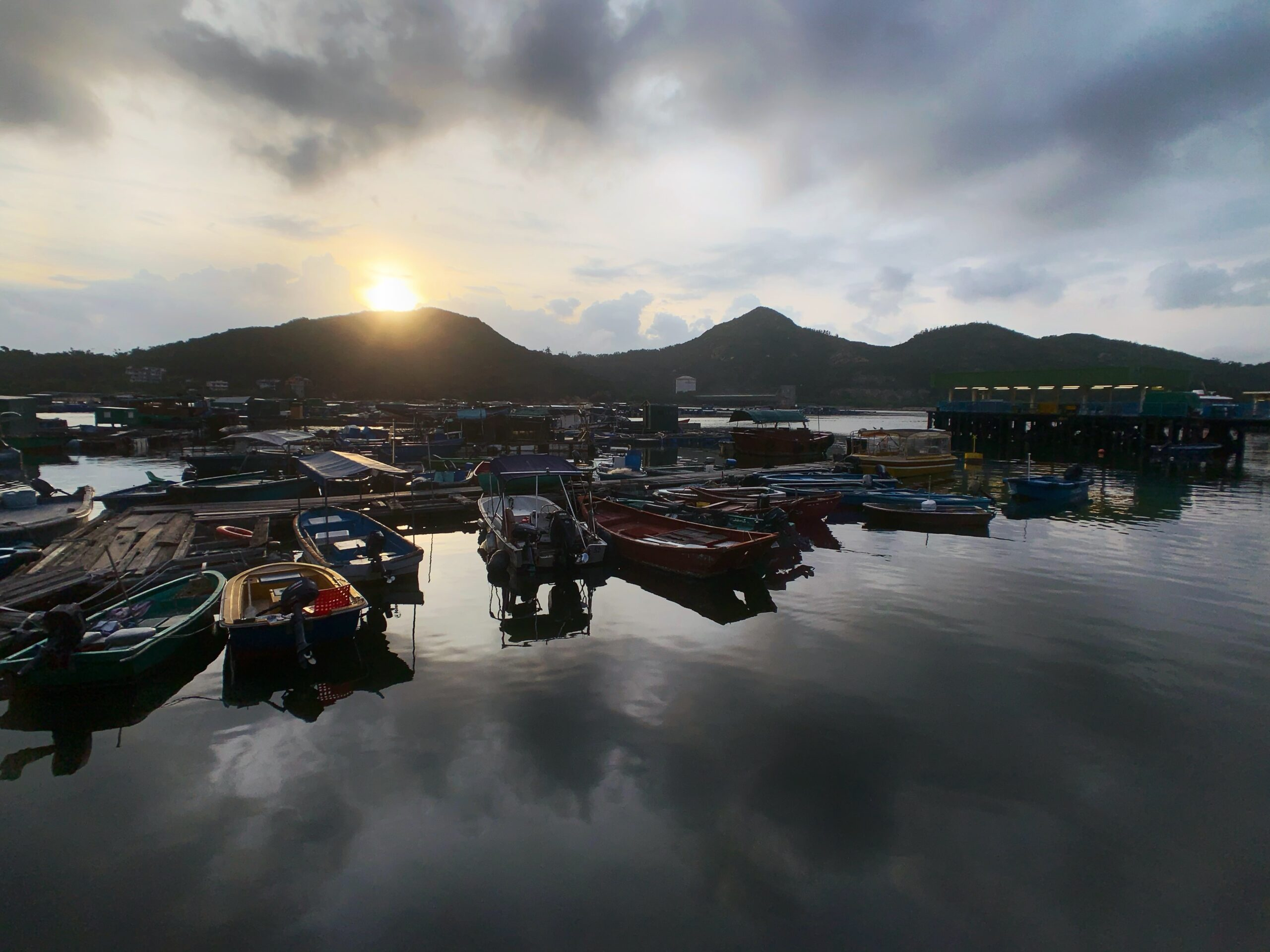 sunrise view over boats in Lamma Island Hong Kong